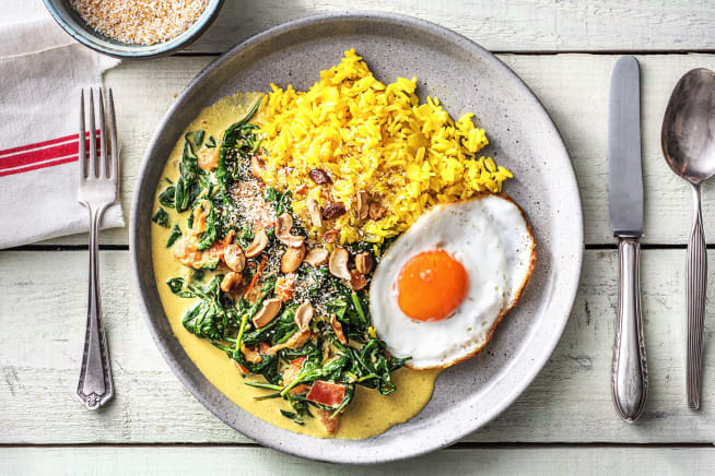 Blije kip leverancier - Gele rijst met spinazie-kokoscurry