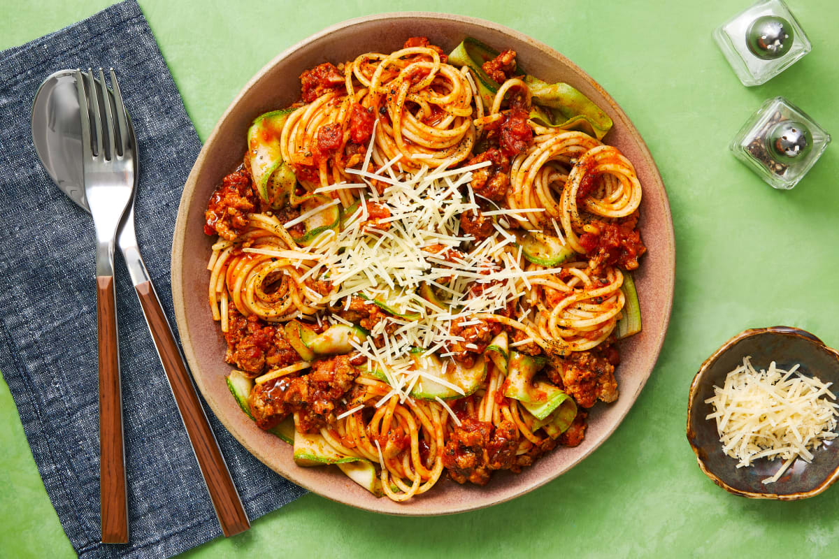 Pork Sausage Spaghetti Bolognese with Zucchini Ribbons and Parmesan