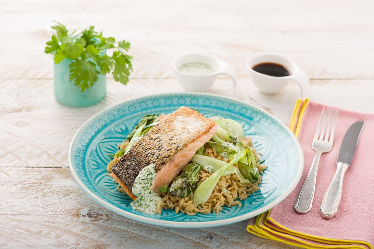 Crispy Pan-Seared Salmon with Baby Bok Choy, Cilantro-Wasabi Dressing, and Soy-Infused Brown Rice