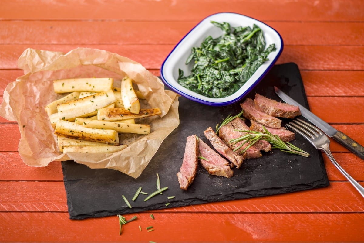 Rosemary-Basted Steak with Roasted Parsnip Wedges and Garlicky Creamed Spinach
