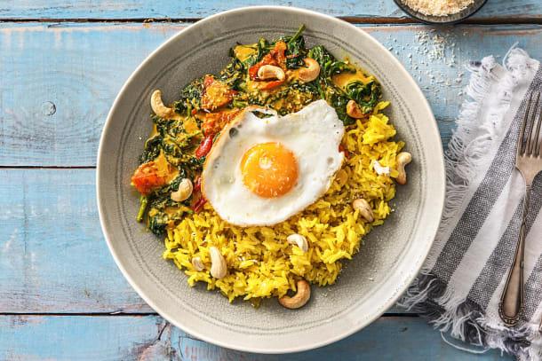 Gele rijst met spinazie-kokoscurry