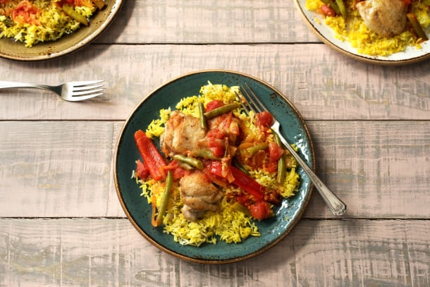 Afrikanisches Schweins-Curry zu gelbem Reis