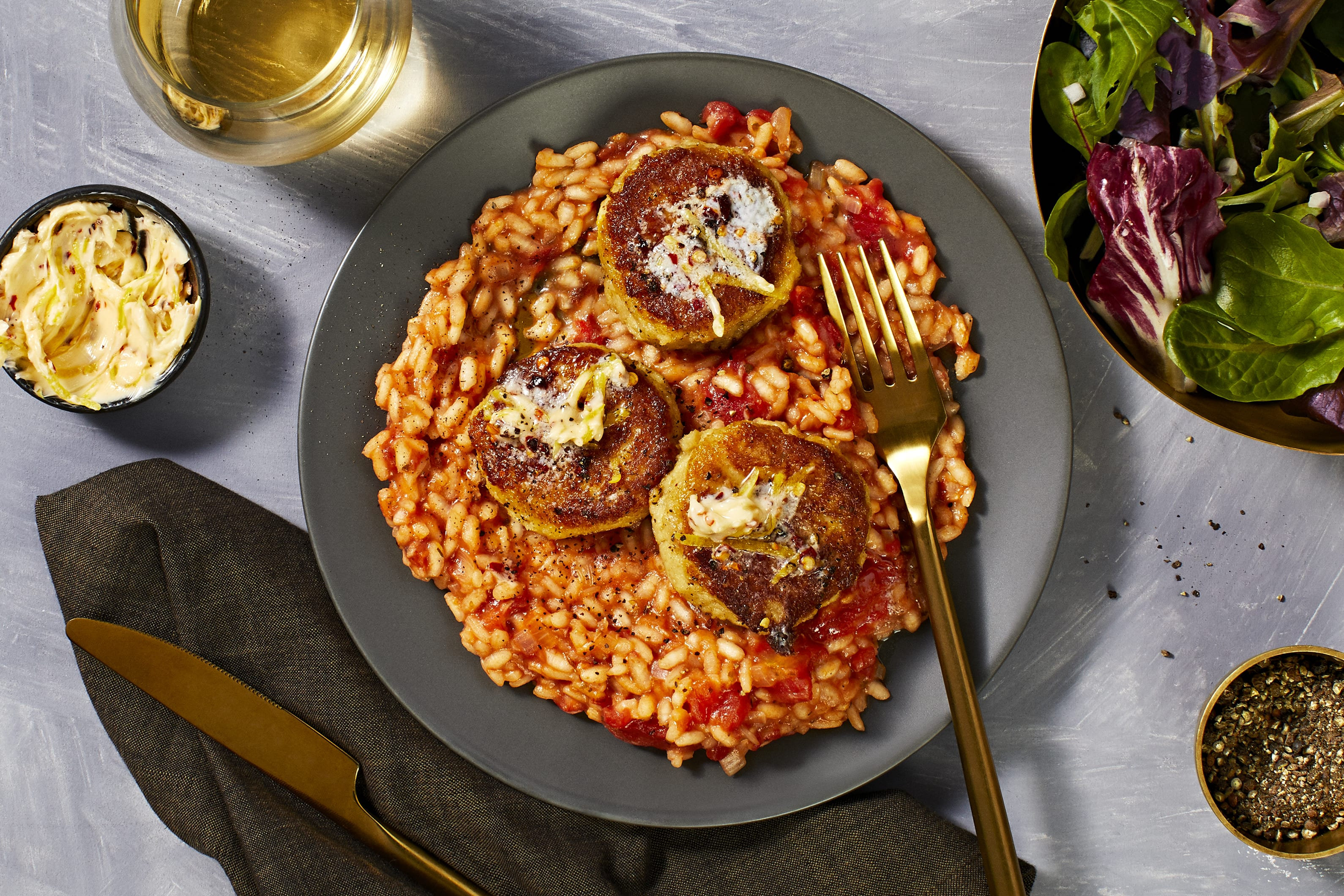 Crab Cakes over Risotto Fra Diavolo