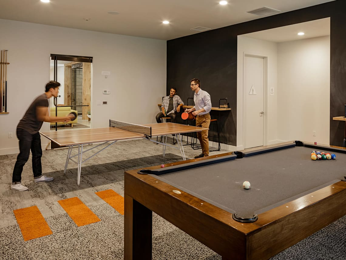 People playing ping-pong at Spruce apartment in Sunnyvale, CA