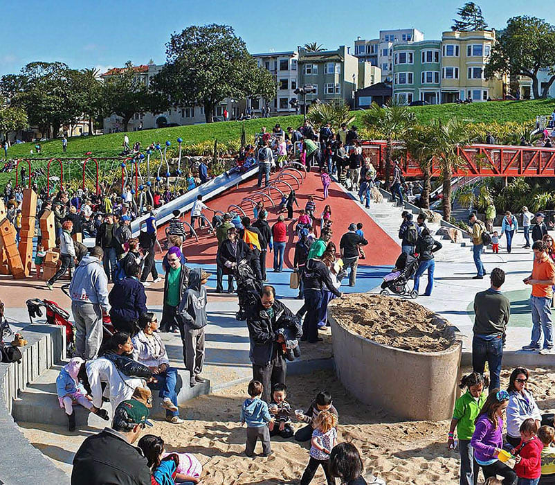 Helen Diller Playground at Dolores Park filled with families