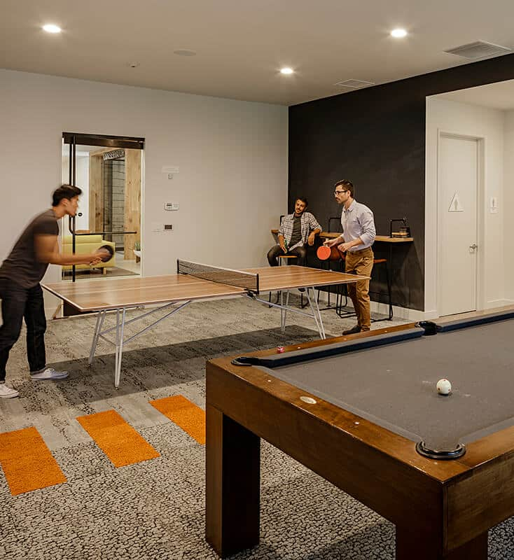 Clubhouse with a ping pong and pool table