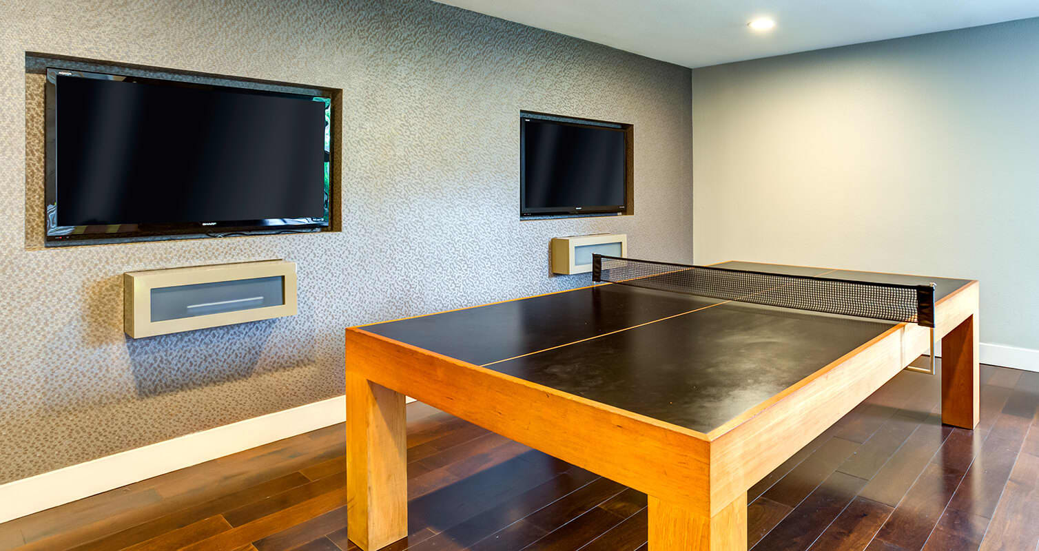 Clubhouse with ping pong table and tv