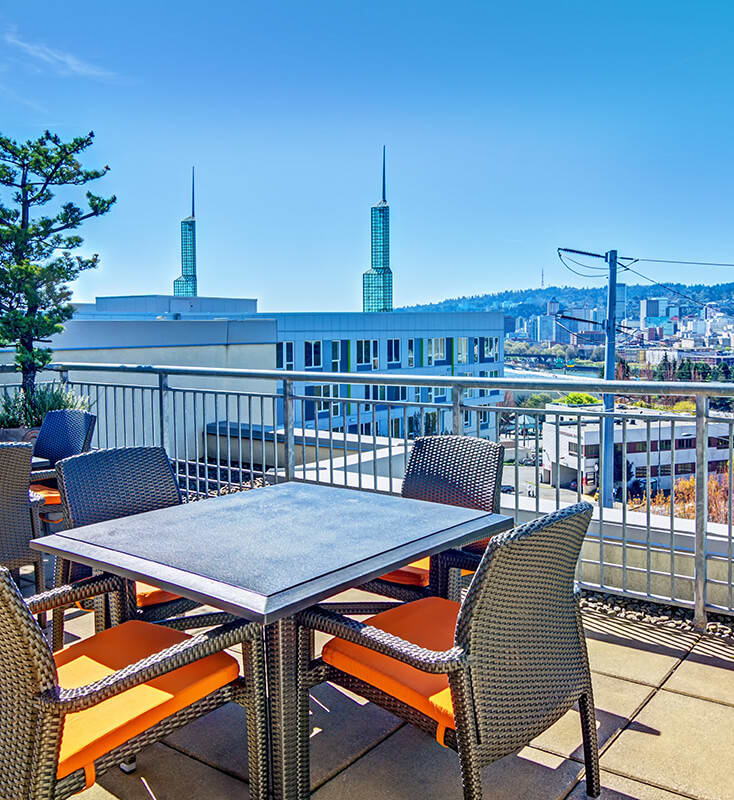 Rooftop with dining chairs and dining table