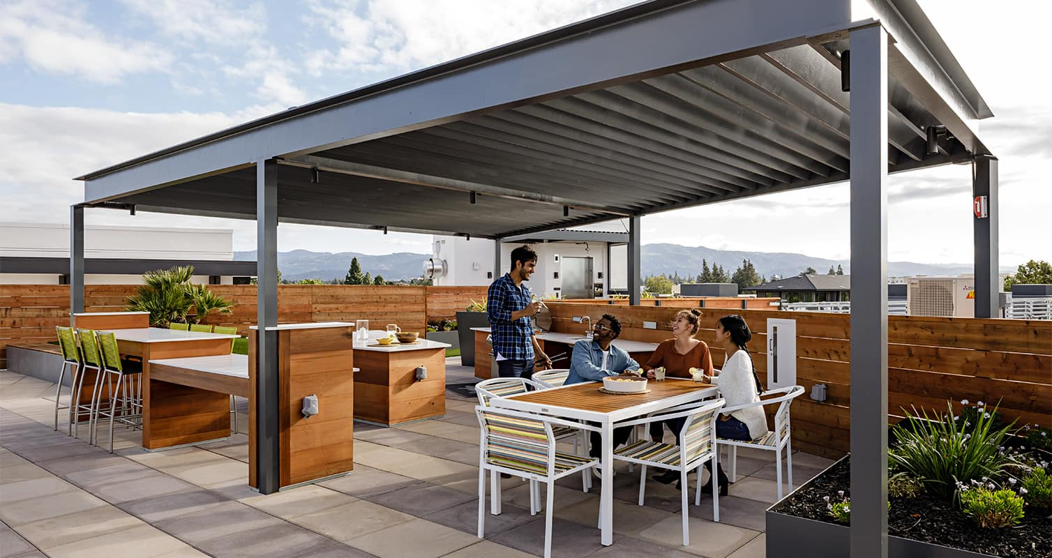 Rooftop wtih bbq and dining tables