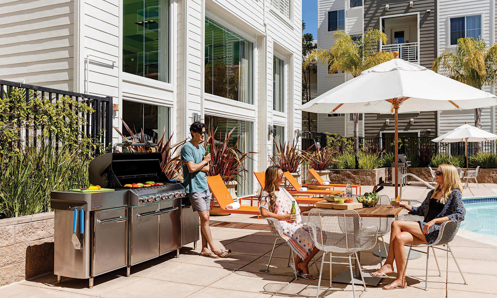 Outdoor patio with BBQ and people dining