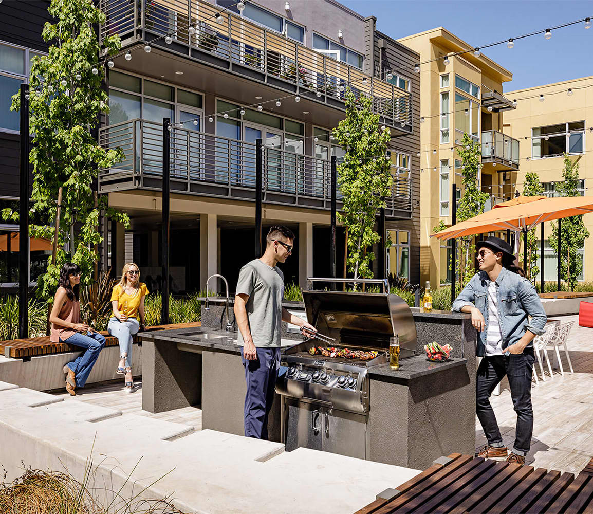 Exterior patio with BBQ and people dining