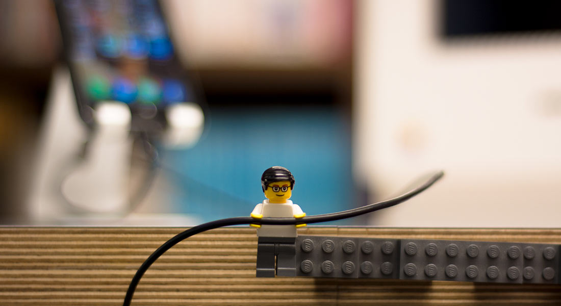 A Lego figure holds a wire