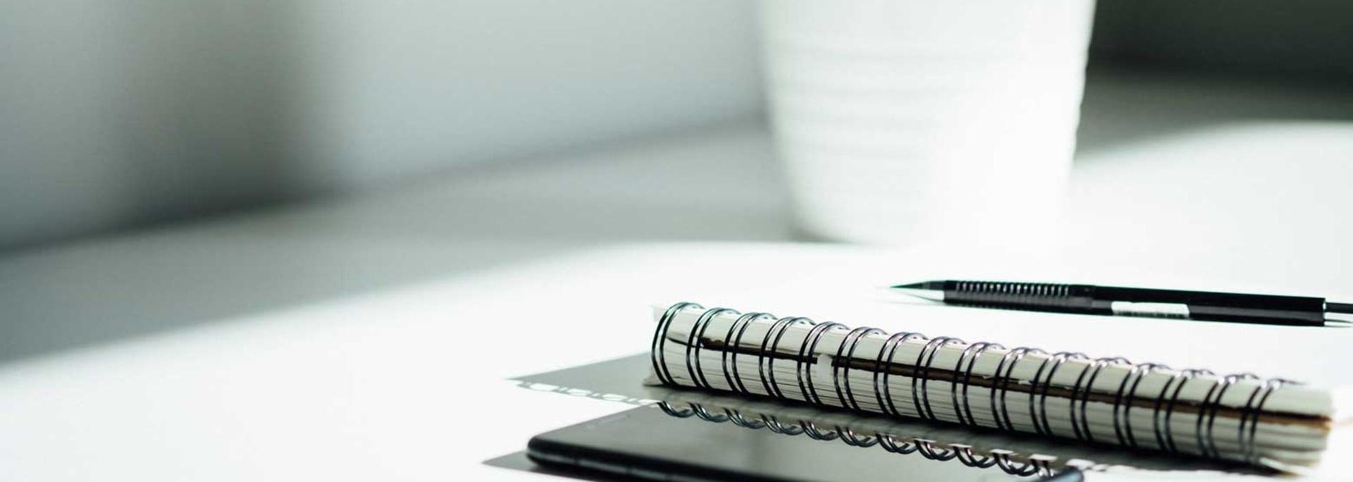 Penna och anteckningsblock