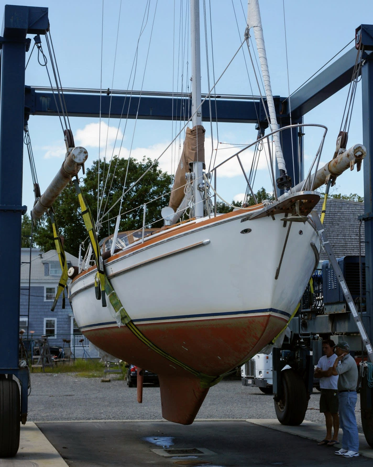 A sailboat out of the water undergoing a survey