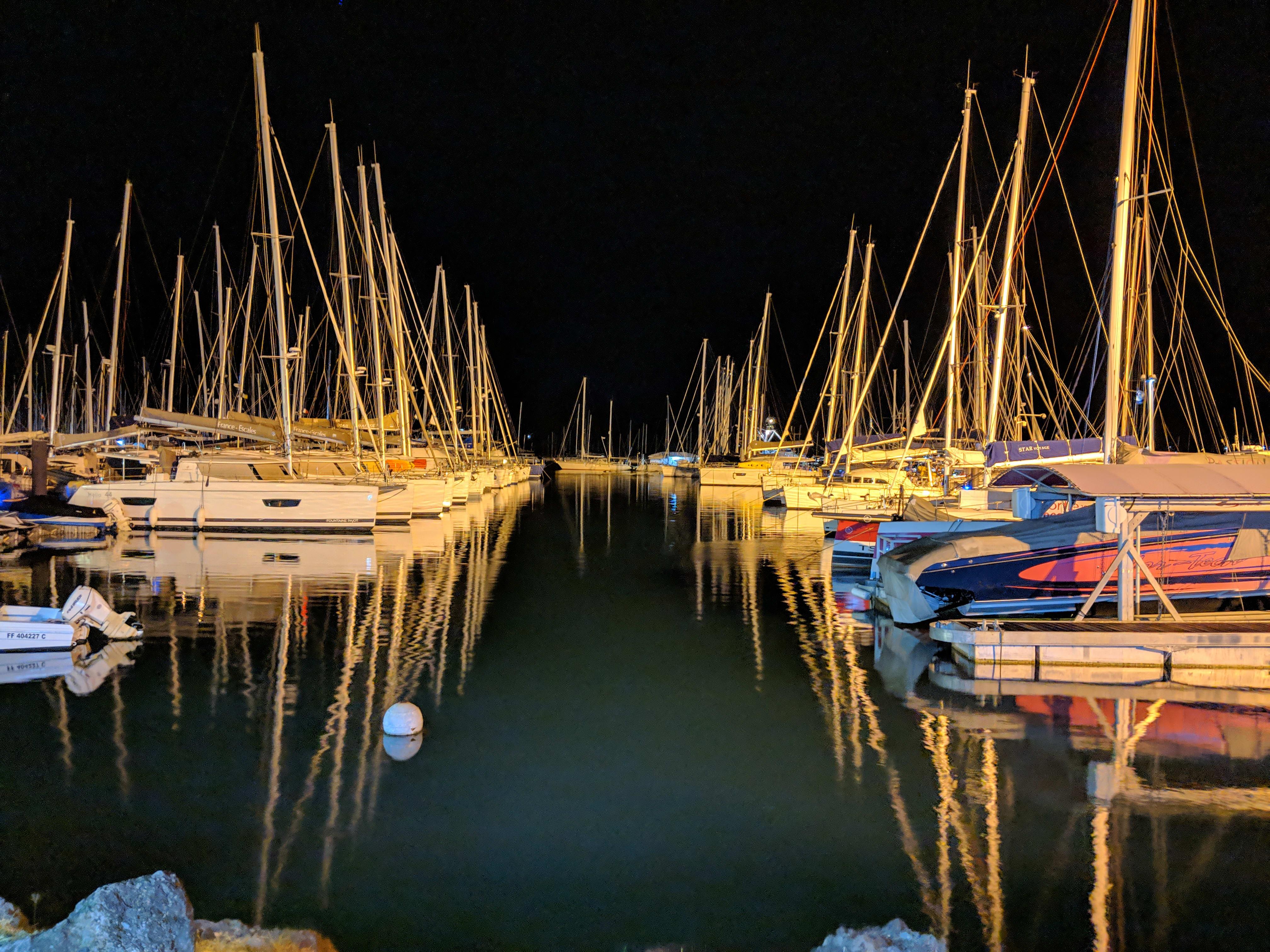 A marina full of sailboats at night