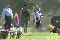 Three men are killed at a cemetery in...