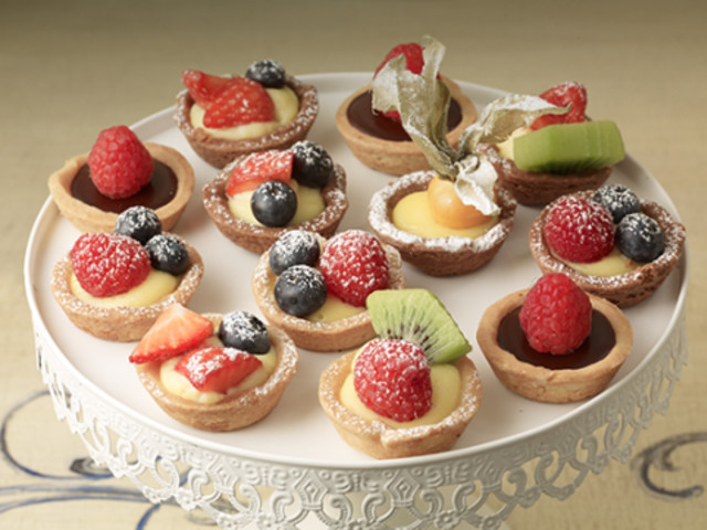 Assortment of cream and in-season fruit tarts Bondi Beach