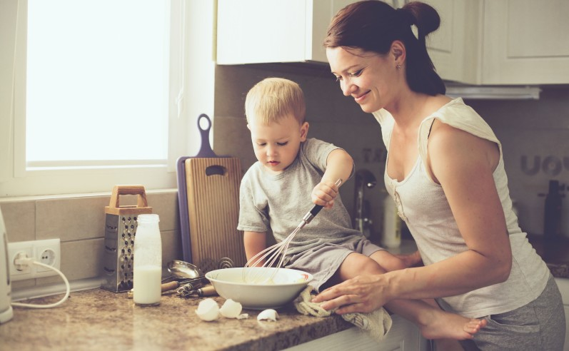 Mother with child cooking together