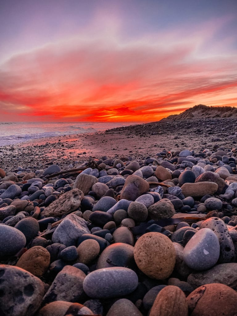 New-castle-pebble-beach-sunrise-1-1-768x1024 Photographing 27 Sites in 48 Hours.