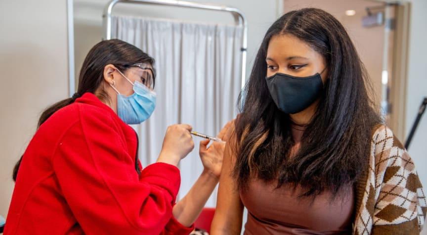 Colleges, States Spar Over COVID-19 Vaccine Mandates