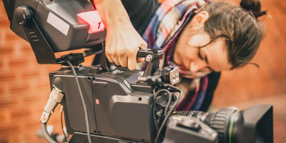 Image of woman operating a film camera