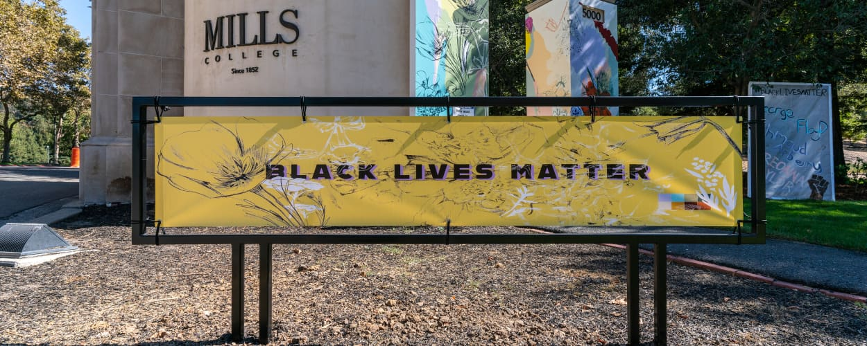 Image of Mills College campus with banner reading 'Black Lives Matter'