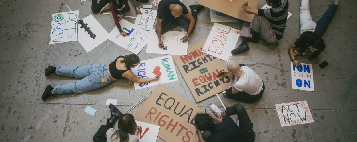 Image of student protesters creating signs