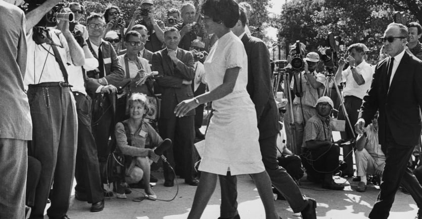 Vivian Malone and James Hood walk through the crowds as they become the first Black students to enrol at the University of Alabama in Tuscaloosa, Alabama, on June 11, 1963.