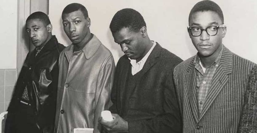 A photograph of four Alabama State University students who were expelled for staging a sit-in at Montgomery County Courthouse in 1960.