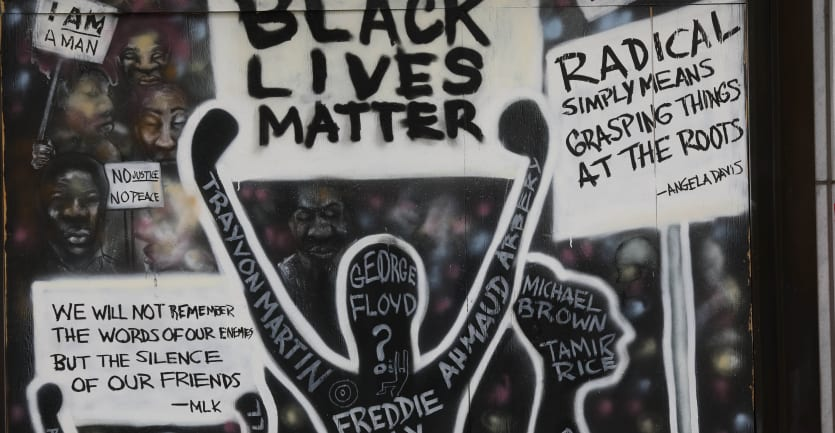 A painted Black Lives Matter collage that includes several abstract figures holding up protest signs.