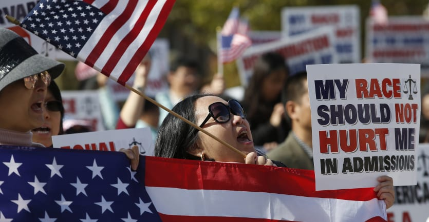 A woman cheers at a rally in Boston's Copley Square to support Students for Fair Admissions' lawsuit against Harvard University and to protest Harvard's alleged anti-Asian discrimination in admissions on Oct. 14, 2018.