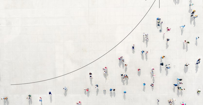 A photo-illustration reveals an overhead shot of scattered groups of people on a white gridded background, aligned along an upward-climbing arrow.