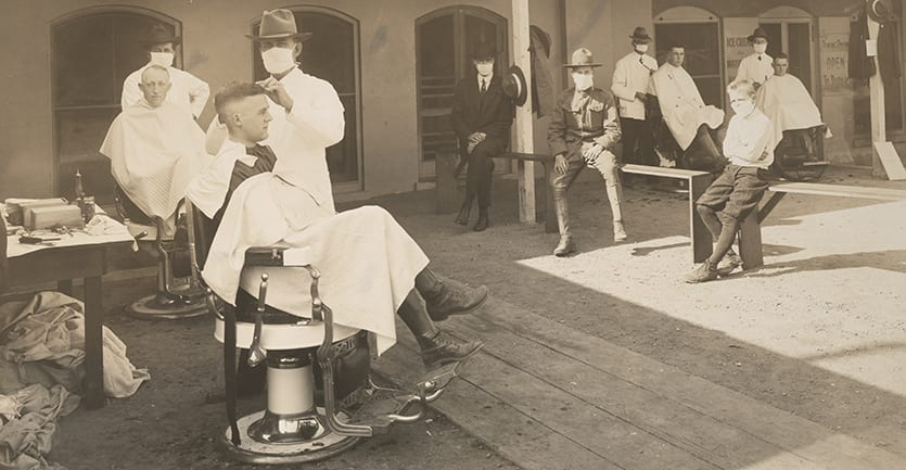 An open air barbershop at the University of California during the Spanish flu pandemic.