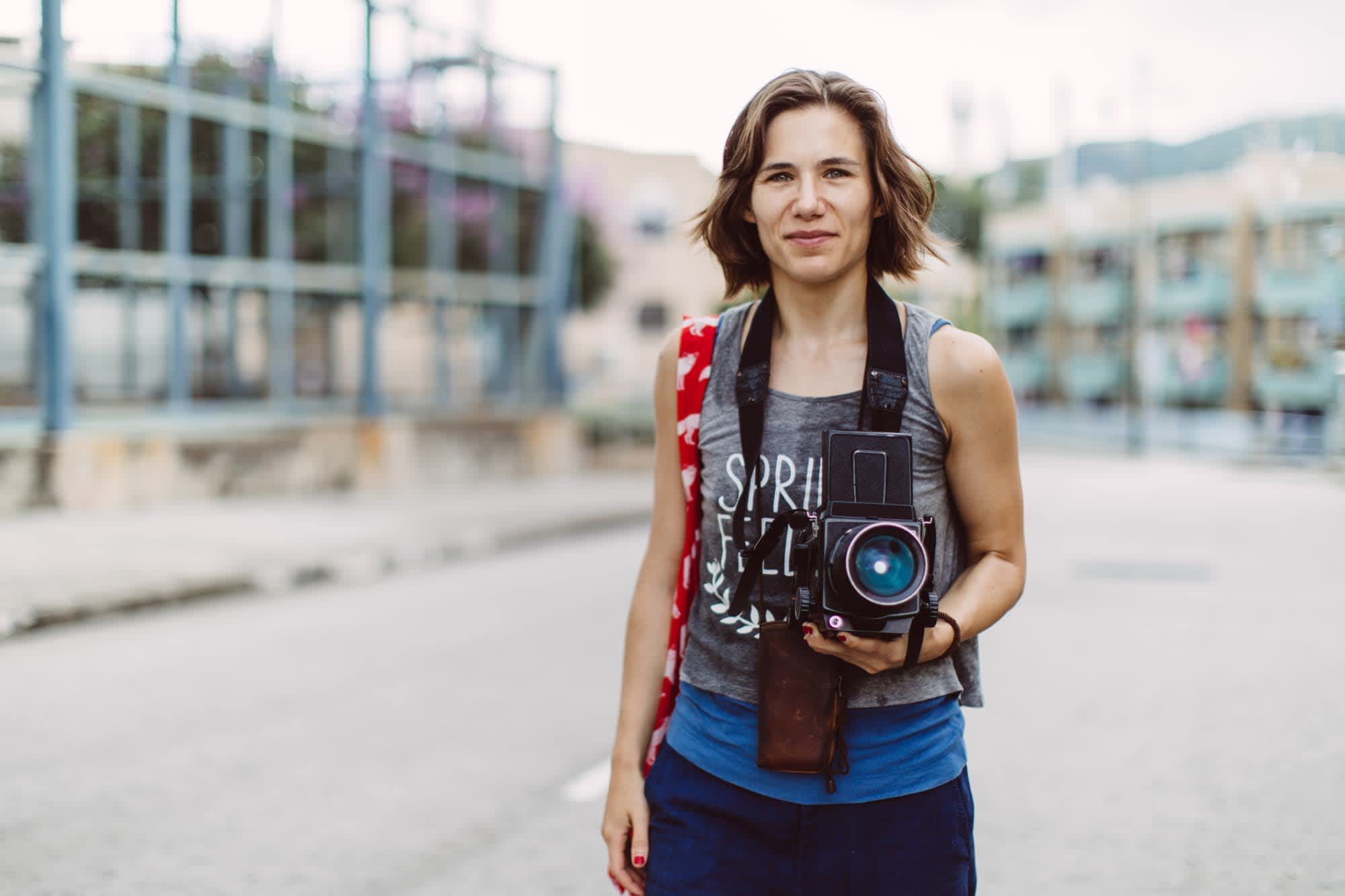 young woman holding vintage film camera