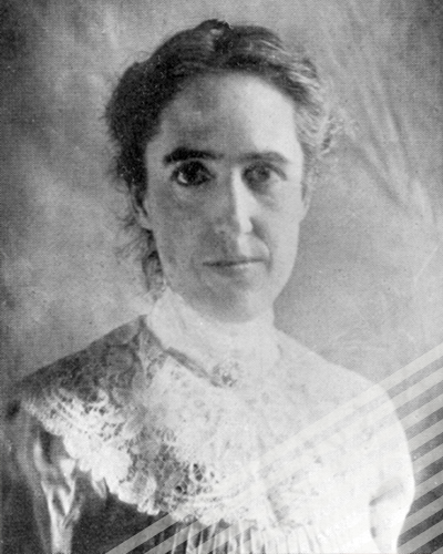 A black and white photograph of Henrietta Swan Leavitt, staring directly into the camera with her hair pinned back.