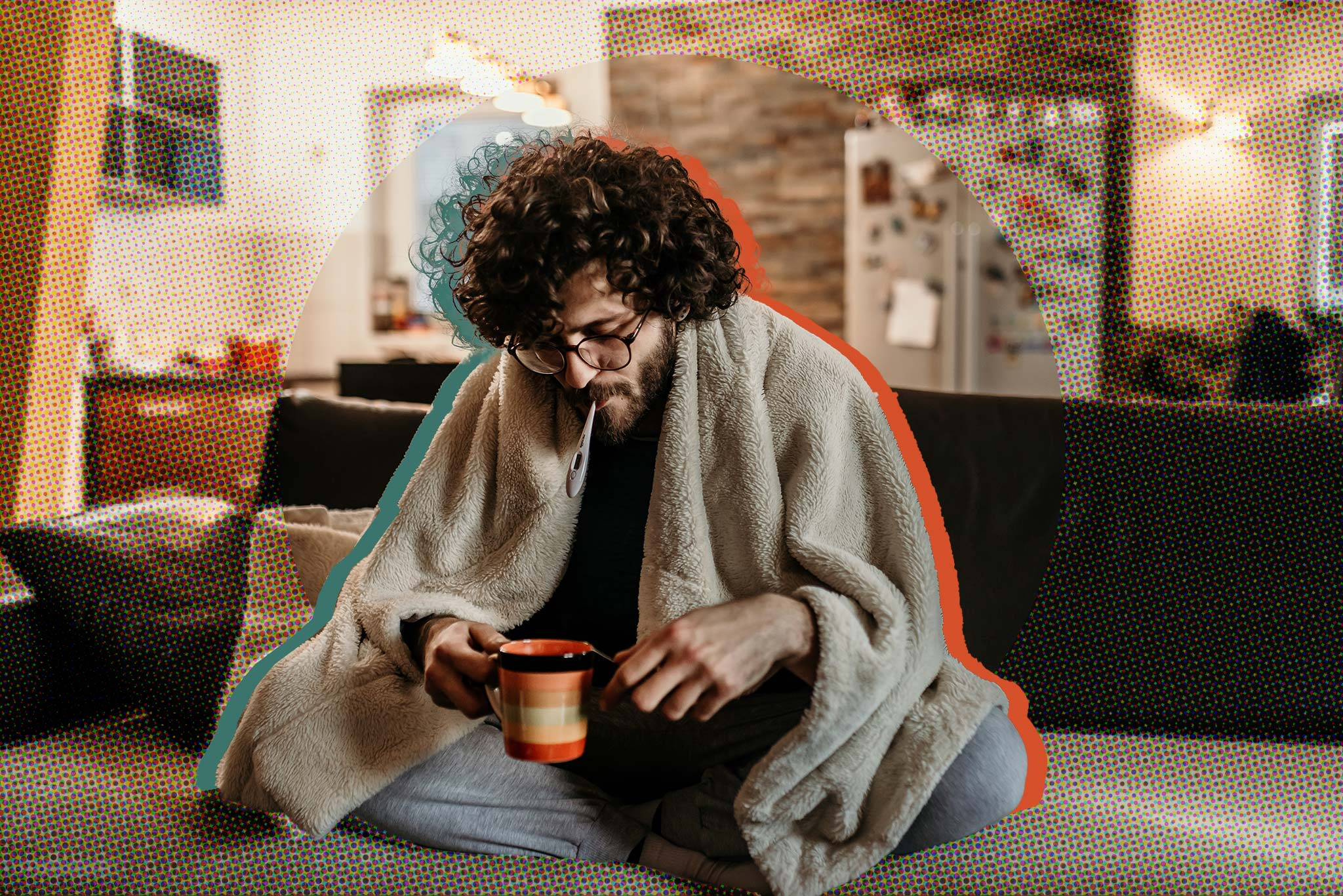 Image of a sick student at home, wearing a blanket and drinking tea