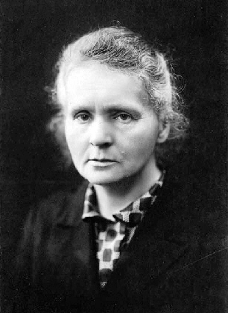 A black and white photograph of Marie Curie, circa 1920.