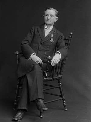 Black and white photo of Dr. Mary Walker sitting on a chair