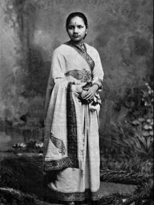 A black and white photo of Anandi Gopal Joshi standing and looking toward the camera
