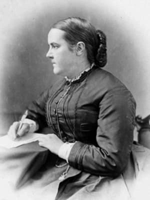 Black and white photo of Sophia Jex-Blake writing and looking away from the camera