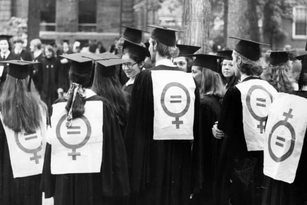 Several graduates don women's liberation signs at Harvard's commencement on June 15, 1972.