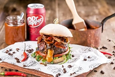 This Burger Has a Molten Cheese-Stuffed Patty and Smoky Dr Pepper BBQ Sauce