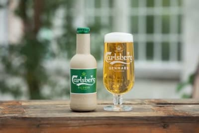 Carlsberg and Coca-Cola to Convert to Plant-Based Paper Bottles
