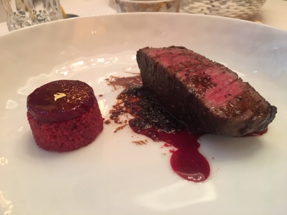 Hanwoo beef with black truffle jam, beetroot couscous, cacao vinegar and hibiscus oil
