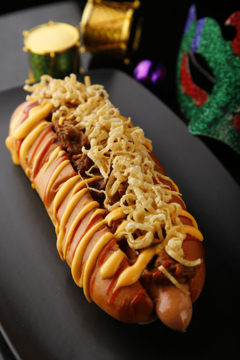 Supersized hot dog with braised beef and cheese sauce