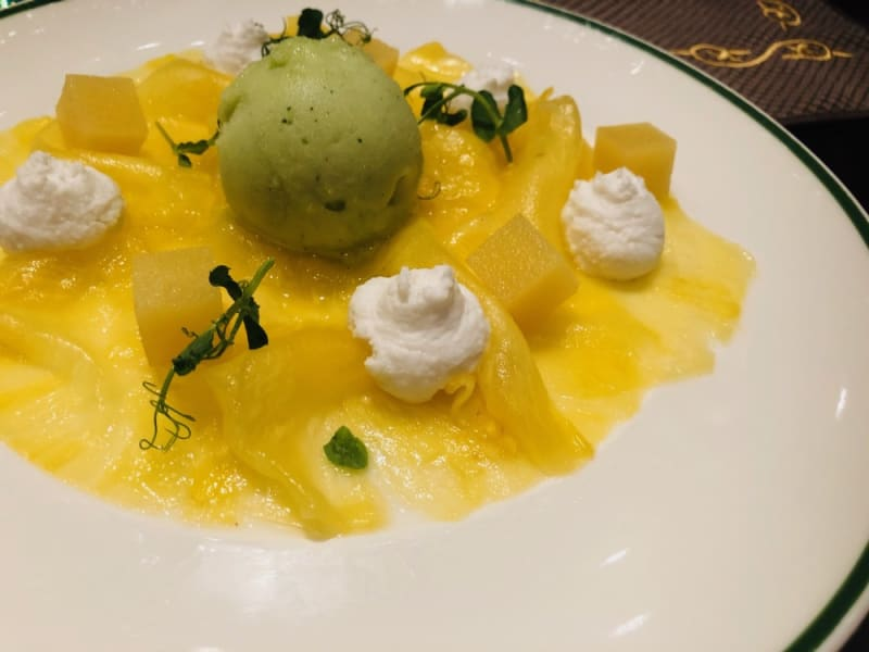 Pineapple carpaccio with lemon and mint sorbet, coconut gel and pineapple agar
