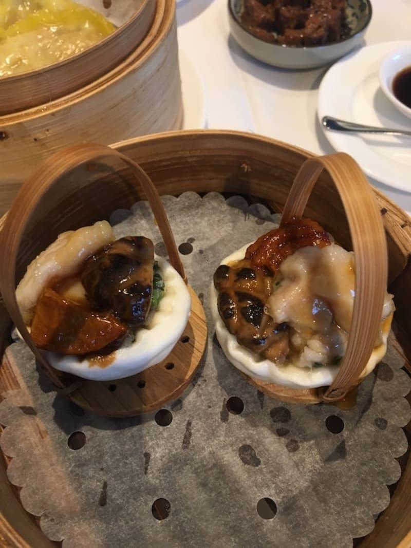 Steamed buns stuffed with chicken, black mushroom, BBQ pork, shrimp and salty egg yolk at Man Hing Hong Kong