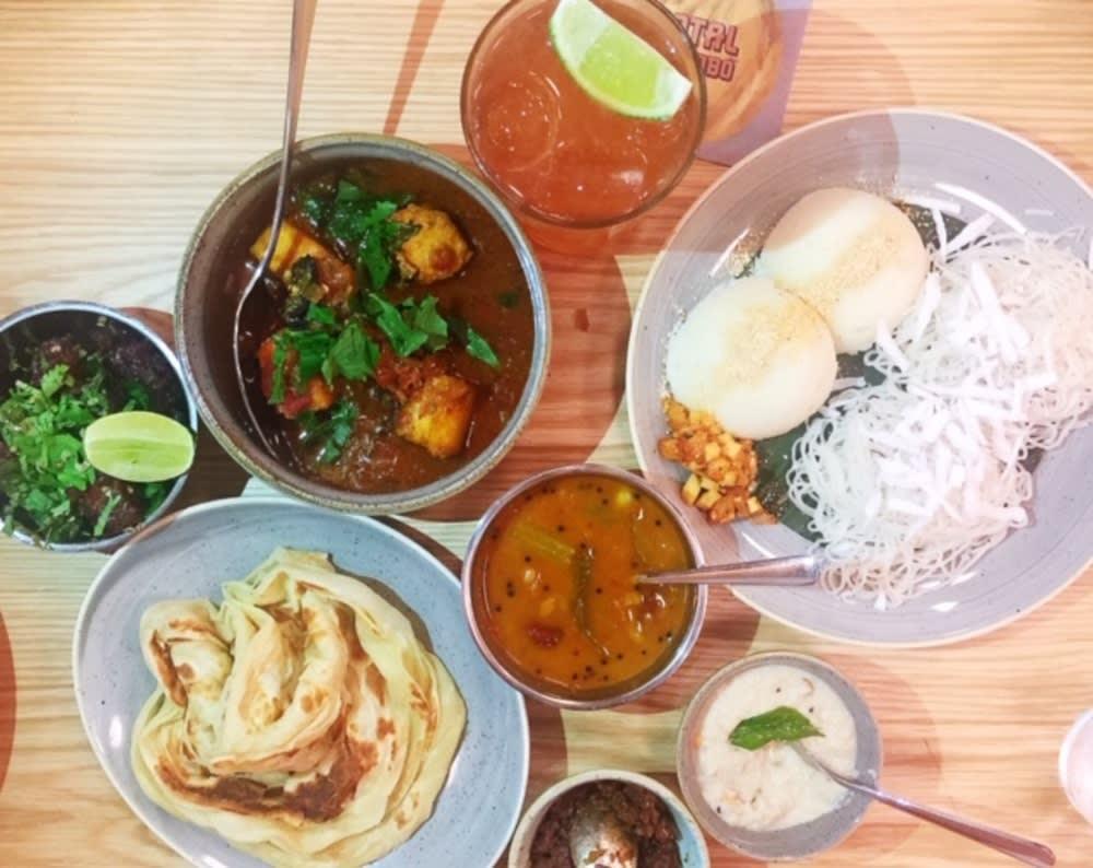 Fish kari, idli, string hoppers, sambar, pol sambol