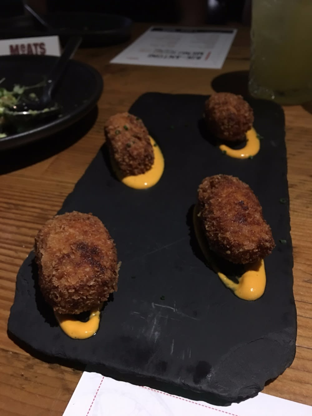 Croquettes with Iberian ham, piquillo pepper and lemon