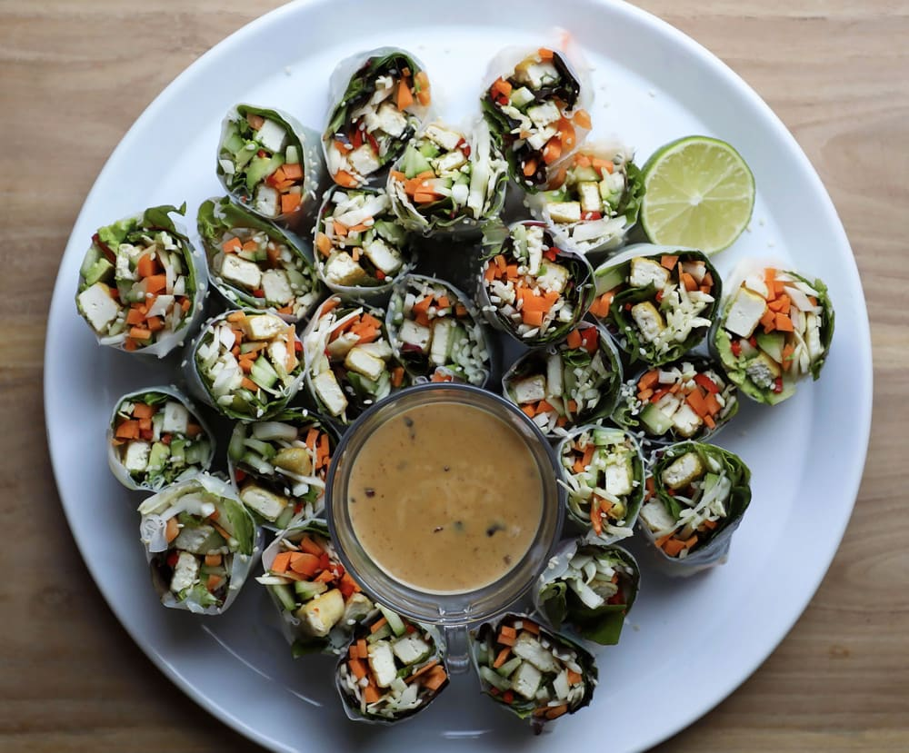 Crispy tofu and avocado rice paper rolls with peanut sauce